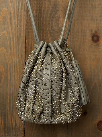 Nevaeh Studded Bucket Bag at Free People Clothing Boutique :  cleobella ikat leather handmade